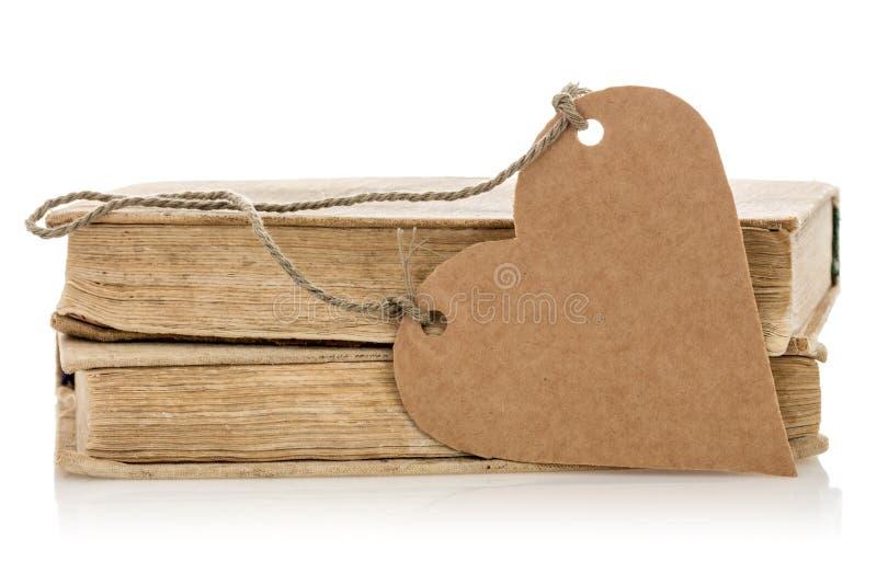Boeken met hart gevormde markering stock afbeelding