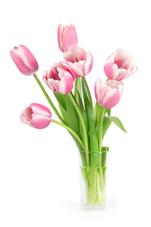 Boeket van tulpen in een glasvaas stock foto's