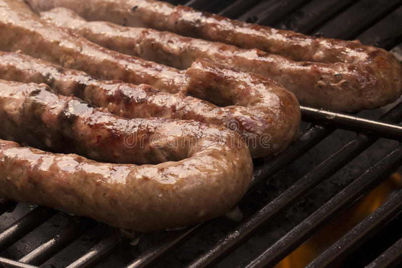 Boerewors on a gas braai. A spicy Barbecued sausage, traditional food from South Africa royalty free stock photo