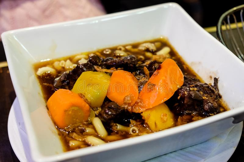 Boeuf Bourguignon served in french bistro in Paris stock photography