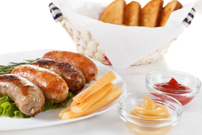 Boeuf de rôti ou saucisse de poulet d'un plat image stock