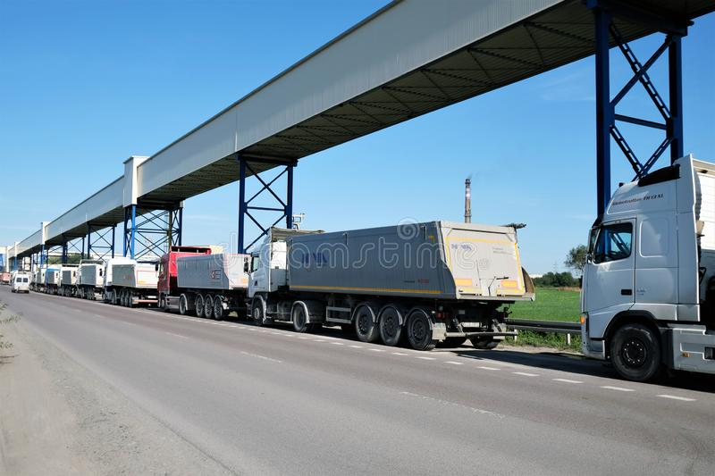 Bogdanka, Poland 09/06/2019 Trucks waiting in line to get loaded with coal at royalty free stock image