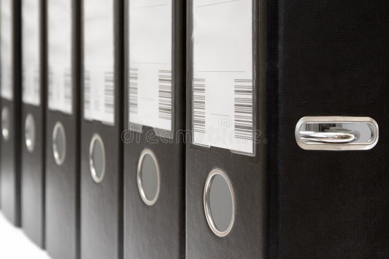 Bogen-Hebel-Dateien in einer Reihe lizenzfreie stockbilder