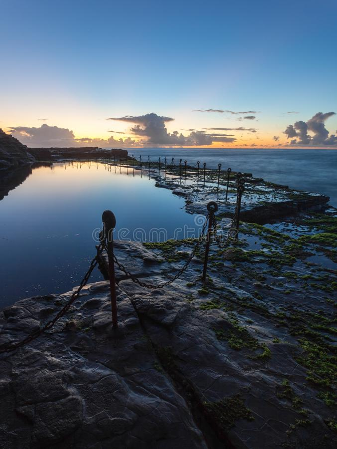 Bogey Hole - Newcastle NSW Australia - Morning Sunrise. Morning sunrise across the Bogey Hole - Newcastle NSW Australia. This convict dug ocean pool dates from stock photos