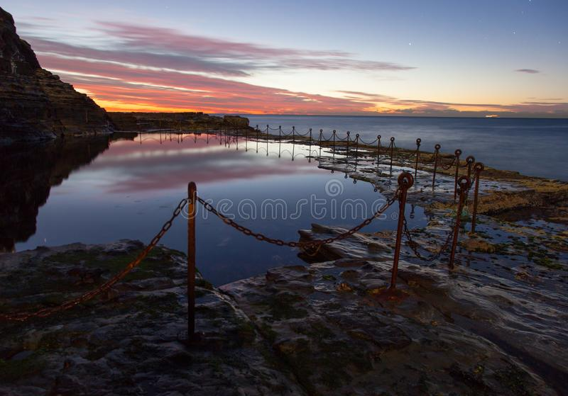 Bogie Hole - Newcastle Australia at sunrise. The Bogie Hole is a famous landmark in Newcastle Australia. It is an ocean pool that was dug with convict labour royalty free stock photos