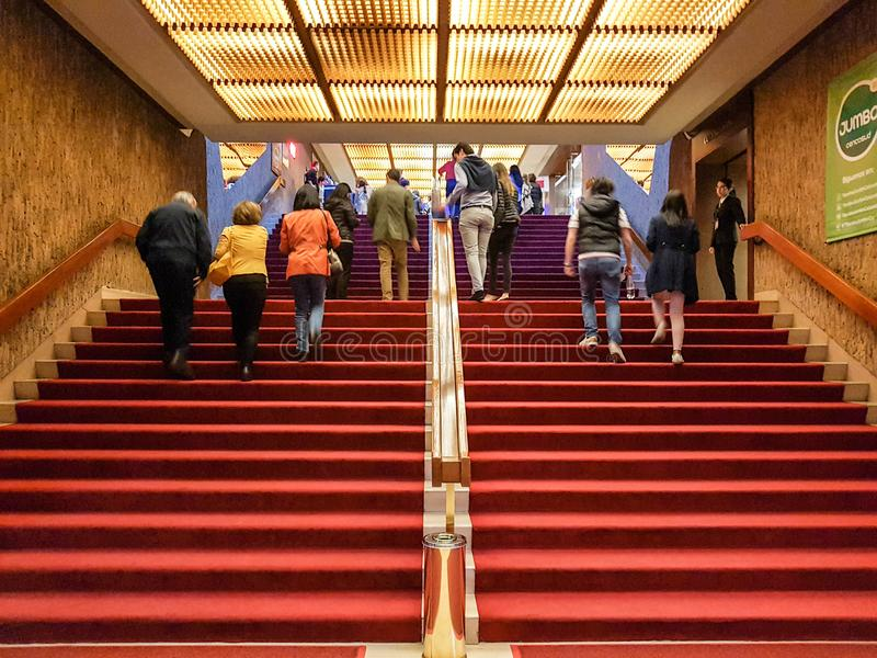 Bogota, Colombia; April 13 2019: People walking in the theatre of colsubsidio, near the el dorado street with red curtains stock image