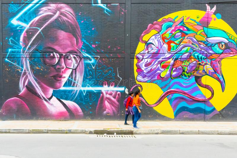 Bogota city mural representing a smoking woman wtih grils. Bogota, Colombia July 9 This mural has been realized on a wall of one of the industrial districts of stock images