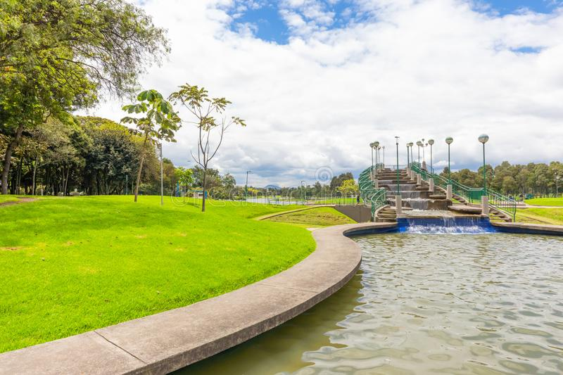 Bogota Simon Bolivar park artificial waterfall. Bogota April 27  Small artificial fall in Simon Bolivar located in the center of the city, proud of the locals royalty free stock image