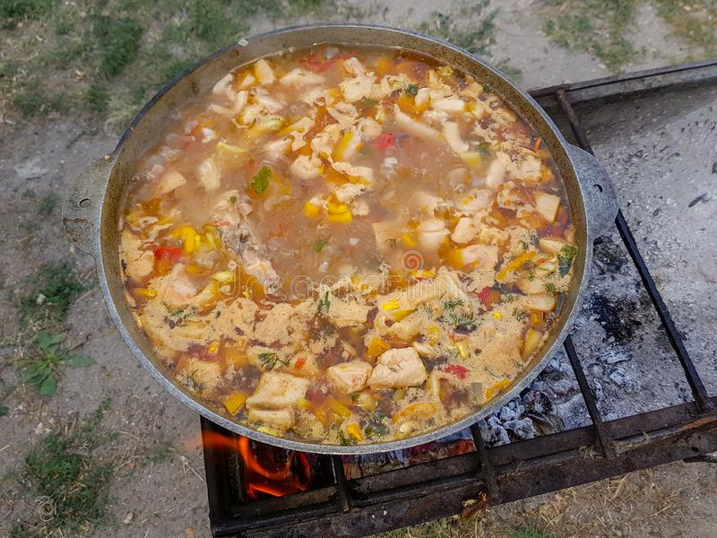 Bograch. Soup with paprika, meat, bean, vegetable, dumpling. Traditional Hungarian Goulash in cauldron. Meal cooked stock photo