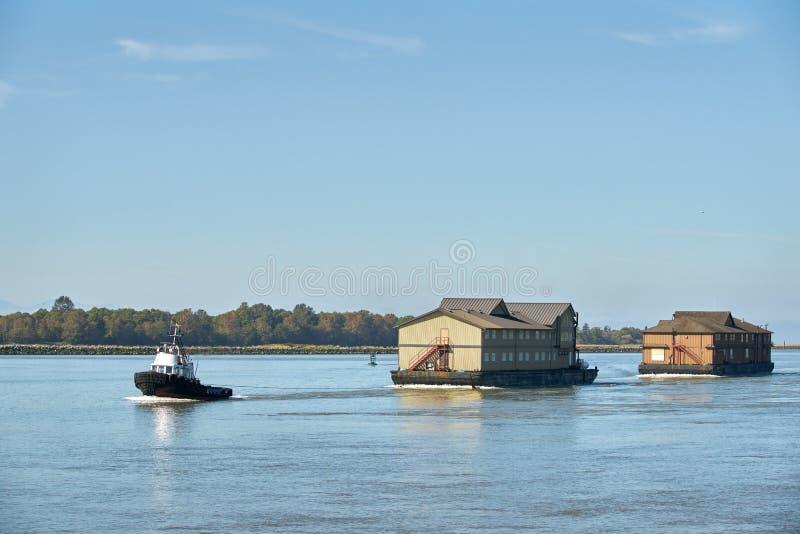 Bogserbåt- och fiskelogar arkivfoton