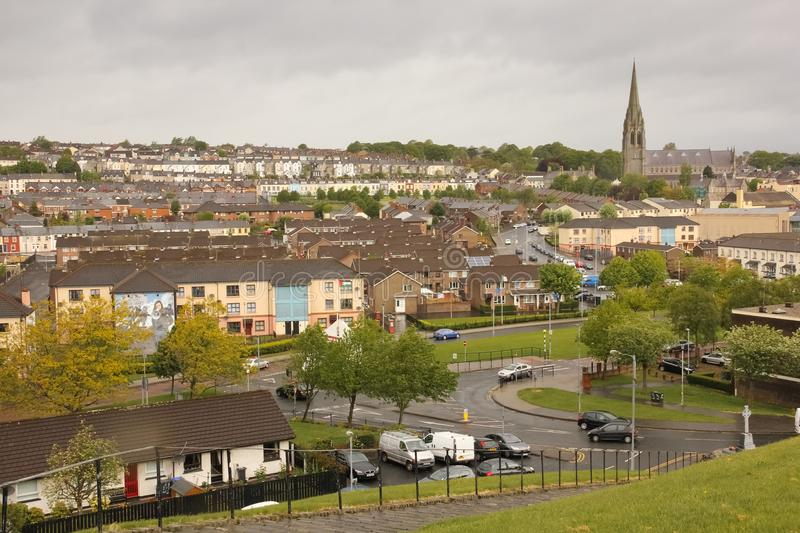 The bogside and St Eugene`s Cathedral. Derry Londonderry. Northern Ireland. United Kingdom. The bogside murals and St Eugene`s Cathedral. Derry Londonderry royalty free stock photo