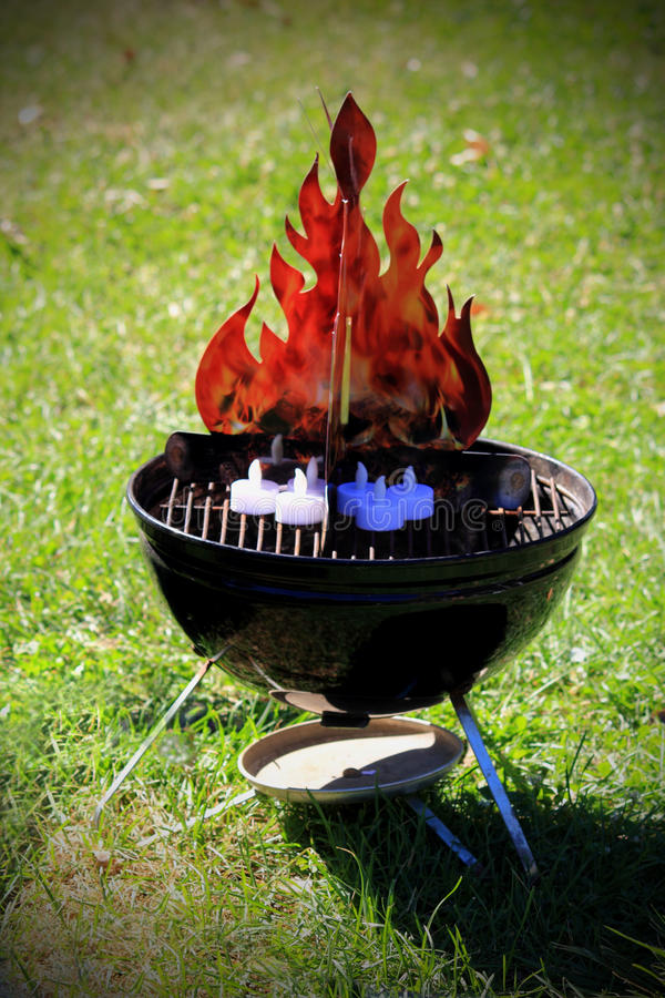 Bogus Fire. Image of an example of a fake or pretend bonfire fire pit. Spoof. Metaphor stock photo