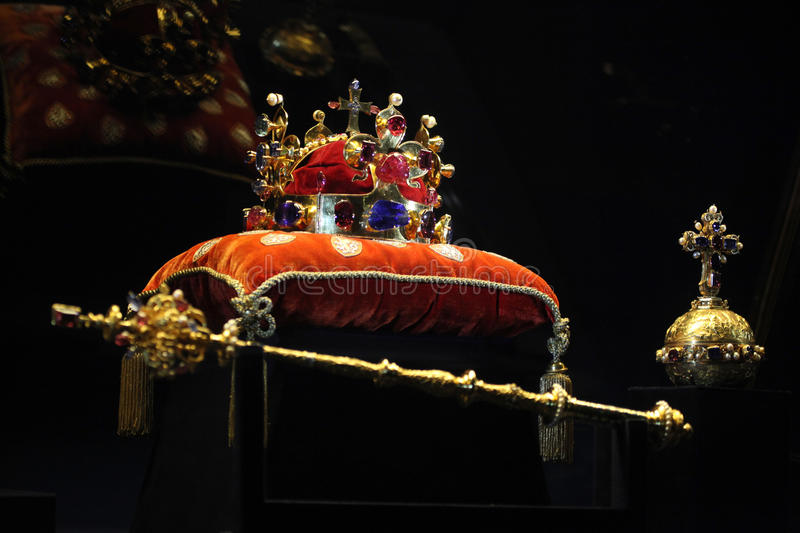 Bohemian Crown Jewels in Prague, Czech Republic. PRAGUE, CZECH REPUBLIC - MAY 10, 2013: Crown of Saint Wenceslas and the Royal Apple and Sceptre displayed at the stock photo