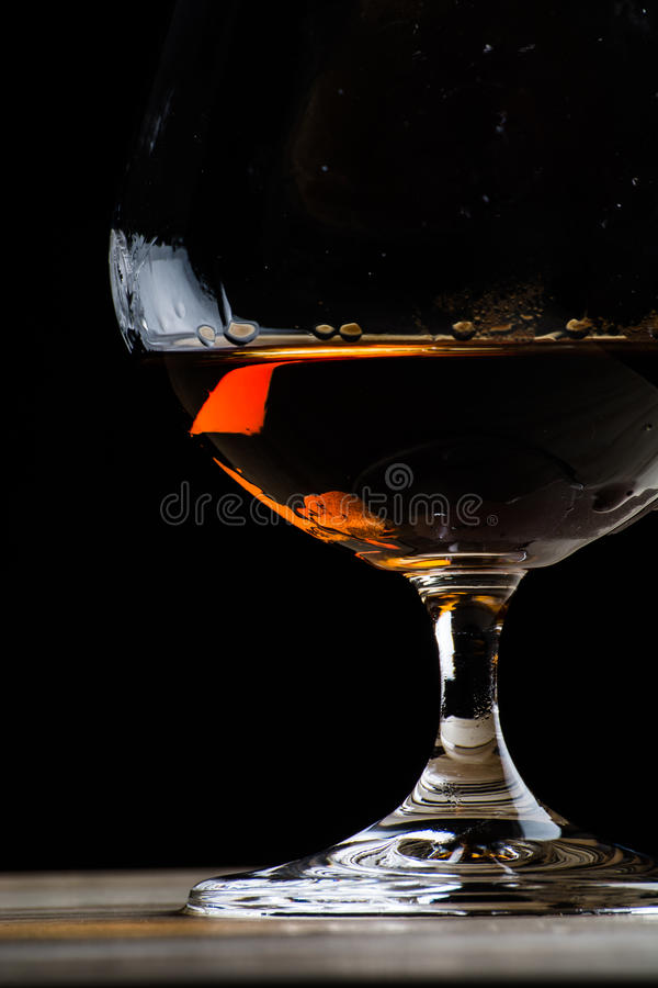 Bohemian glass of cognac royalty free stock photography