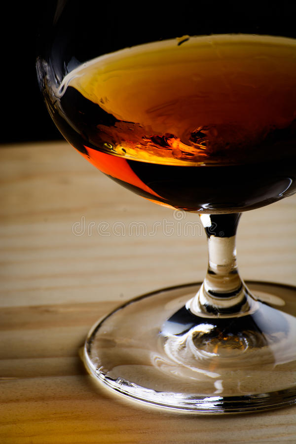 Bohemian glass of cognac royalty free stock images
