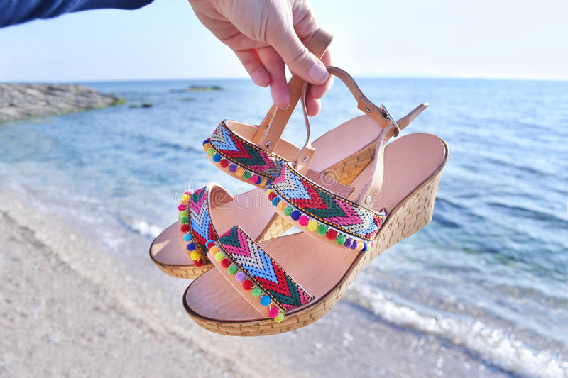 Bohemian greek sandals on the beach royalty free stock photo