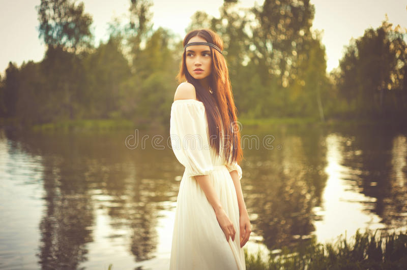 Bohemian lady at river. Outdoors fashion photo of beautiful bohemian lady at river royalty free stock photography