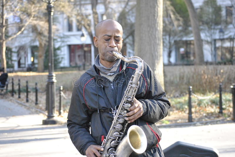 Bohemian saxophone player in greenwich village stock photo
