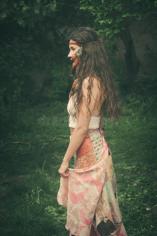 Bohemian style fashion girl outdoor shot. Beautiful bohemian style fashion girl outdoor shot summer day royalty free stock image