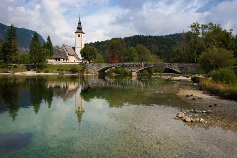 Bohinj lake with church in Slovenia royalty free stock photography