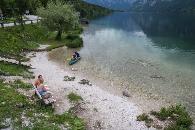 Bohinj, Slovenia - June13, 2018 : people kayaking in scenic lake Bohinj, Slovenia royalty free stock photo