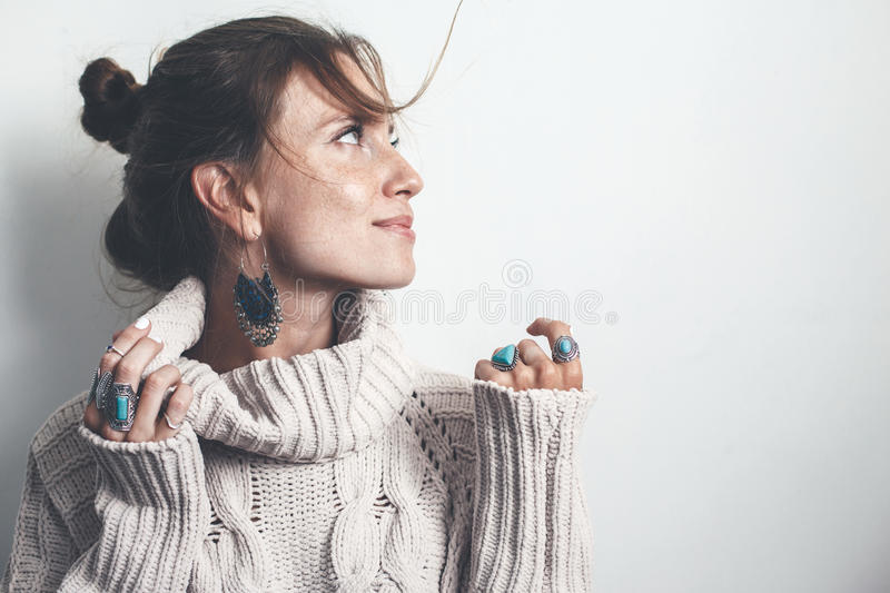 Boho jewelry and woolen sweater on model stock image