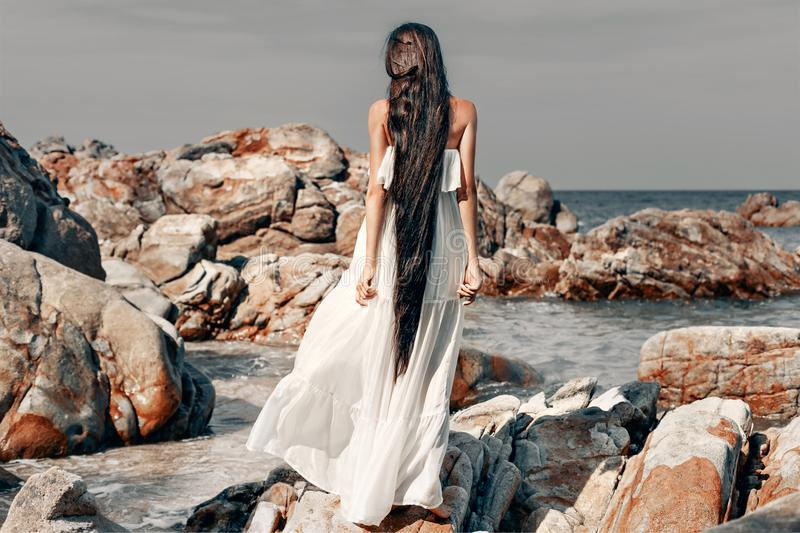 Beautiful young boho style woman in white dress royalty free stock photography