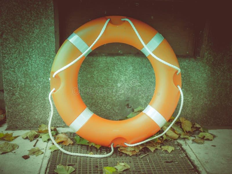 Boia salva-vidas retro do olhar foto de stock