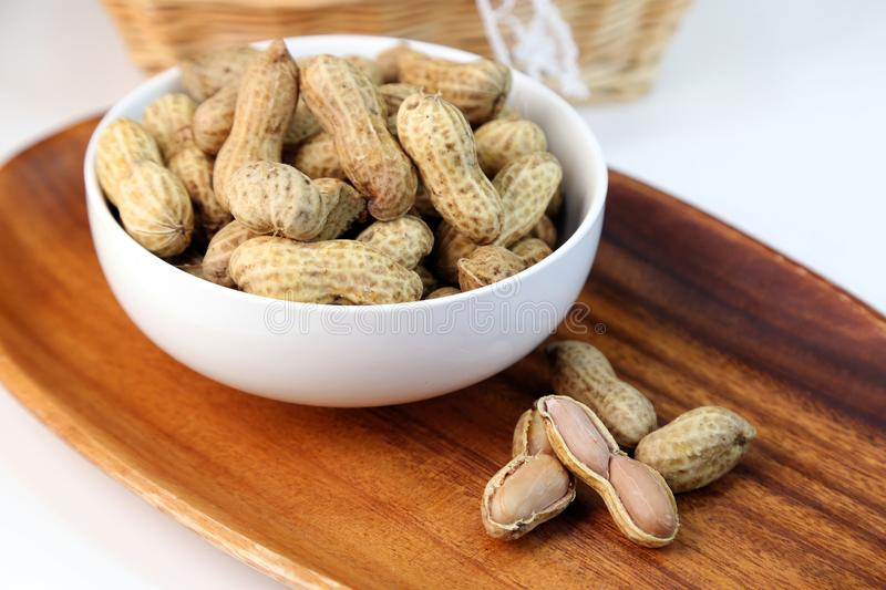 Boil peanuts in salted water. I let I put water and salt in a slightly bigger pan and boil and boil a straight peanut royalty free stock photography