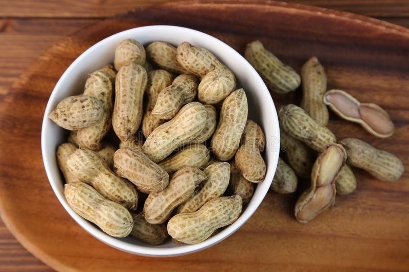 Boil peanuts in salted water. I let I put water and salt in a slightly bigger pan and boil and boil a straight peanut royalty free stock images