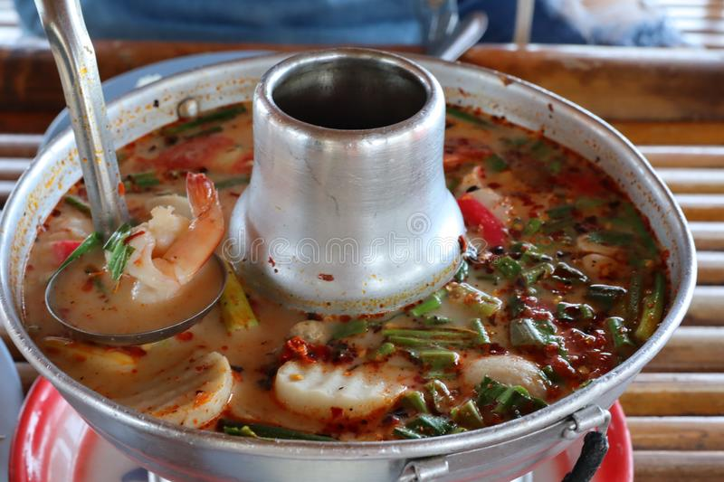 Boil red curry with shrimp, Thai food in a hot pot.  royalty free stock photo