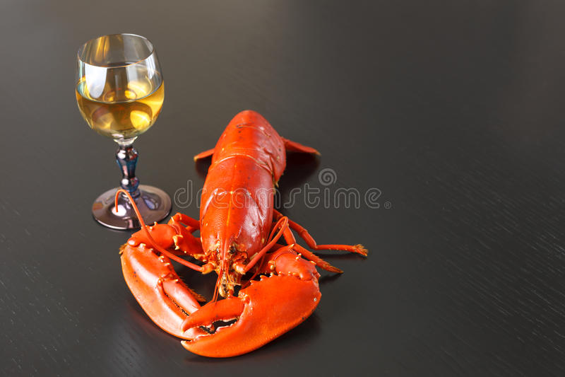 Boiled Atlantic Lobster with glass of white wine stock photography