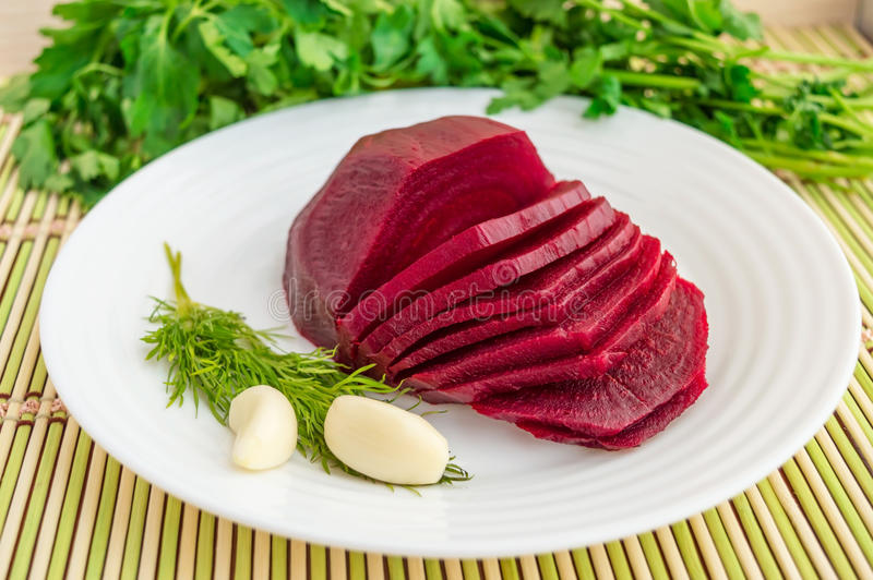 Boiled beet. On a white plate.Lenten dish stock photography