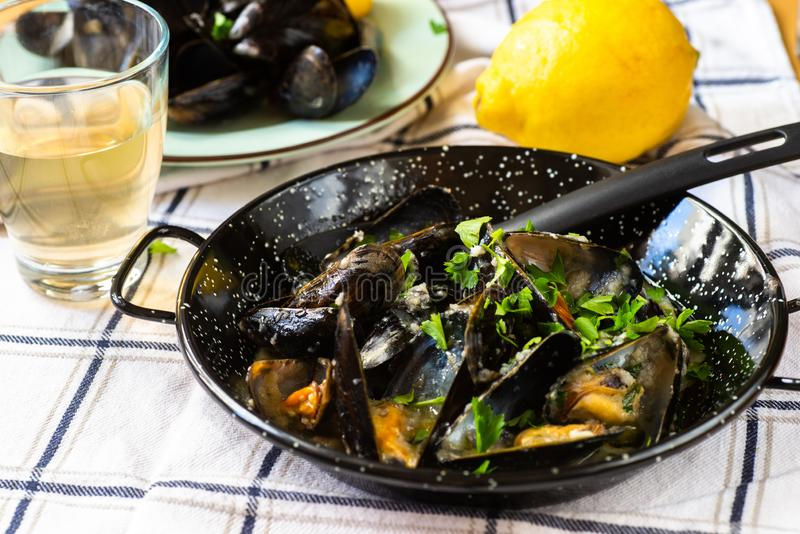 Boiled mussels, vine and lemon royalty free stock image