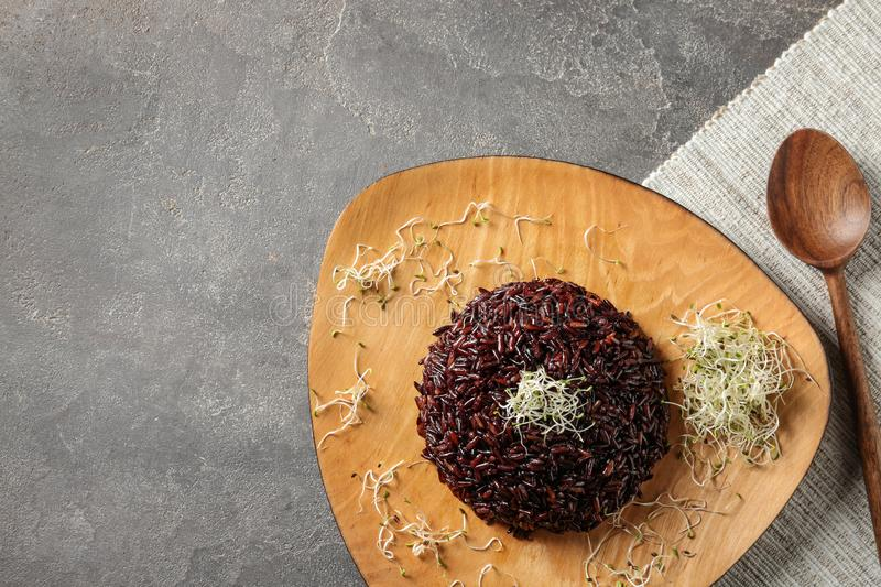Boiled brown rice with sprouted flax seeds served on table, flat lay. Space for text stock photography