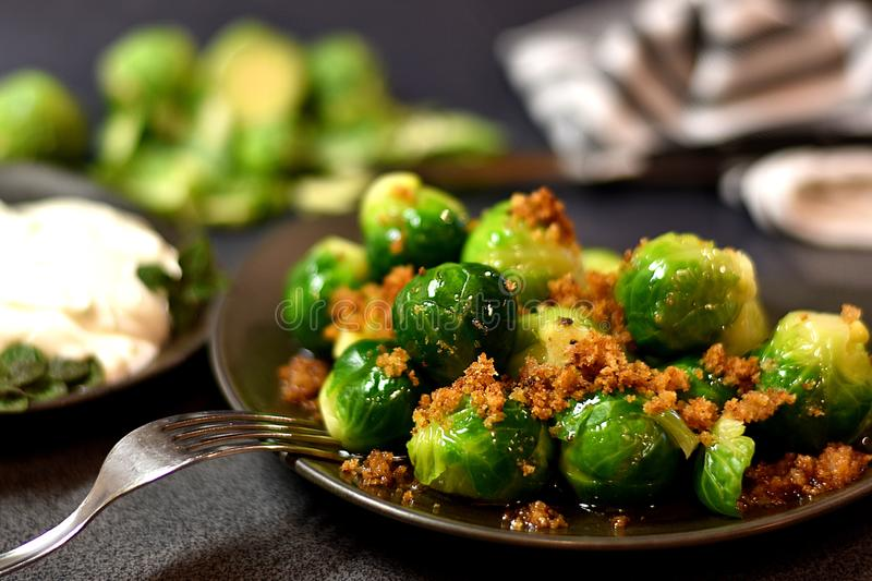 Boiled brussel sprouts on brown plate stock photography