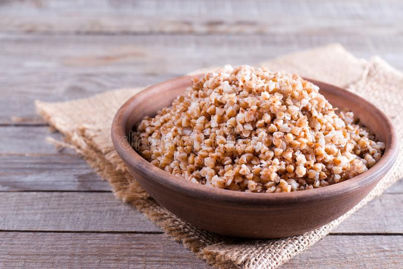 Boiled buckwheat porridge in a ceramic bowl royalty free stock images