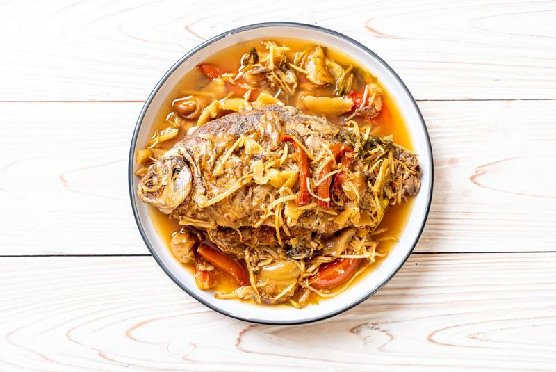 Boiled Carp fish with pickled lettuce. Asian food style stock photos