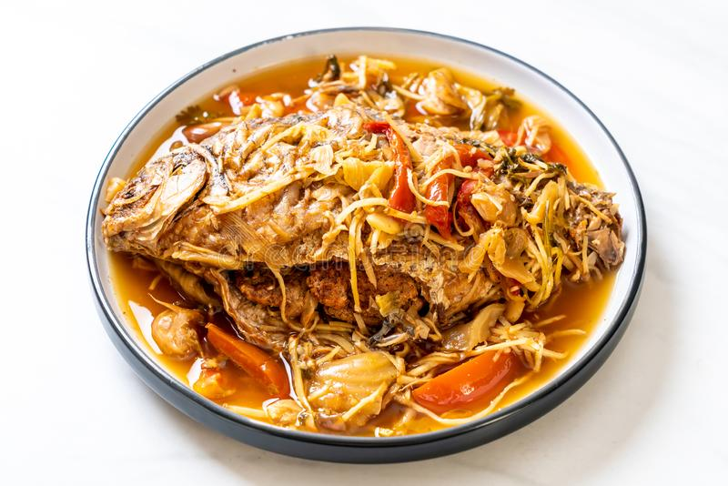 Boiled Carp fish with pickled lettuce. Asian food style royalty free stock images