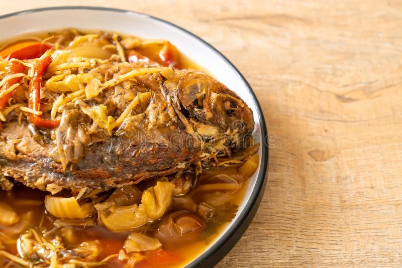 Boiled Carp fish with pickled lettuce. Asian food style stock photo