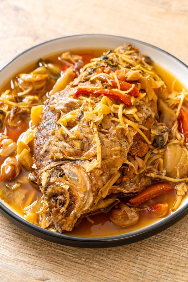 Boiled Carp fish with pickled lettuce. Asian food style stock image