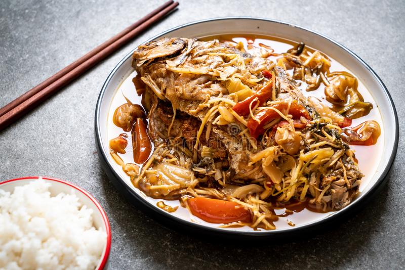 Boiled Carp fish with pickled lettuce. Asian food style stock images