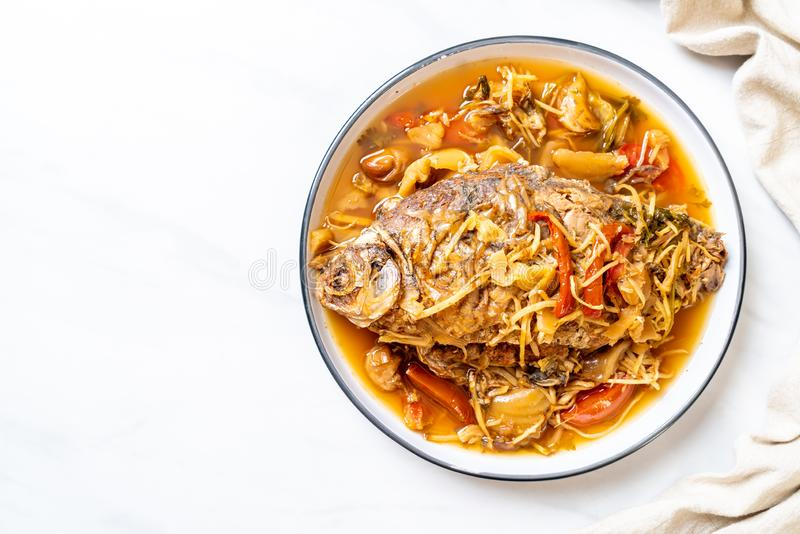 Boiled Carp fish with pickled lettuce. Asian food style royalty free stock photography