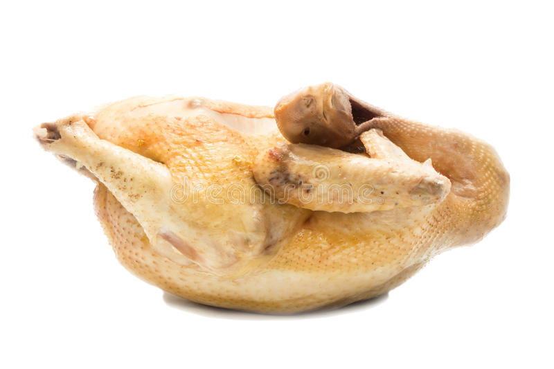 Boiled chicken on white background, whole body, side view. Studio shot stock photography