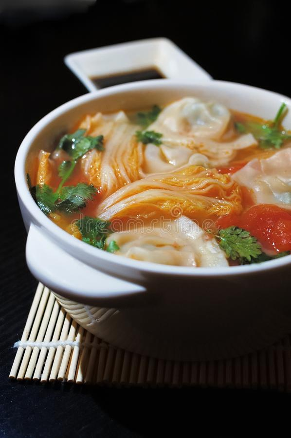 Boiled Chinese Dumplings in Sour Tomato Soup royalty free stock photo