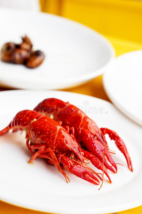 Boiled crawfish. And hearty dishes stock photos