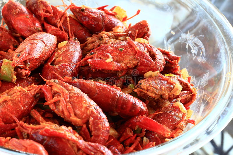 Boiled Crawfish marinated in spices. In a glass bowl royalty free stock image