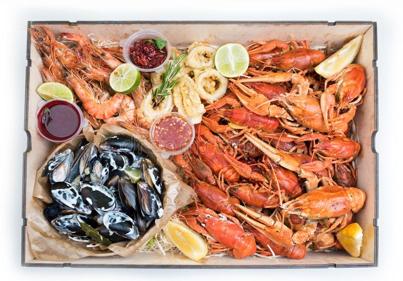 Boiled crawfish, mussels, shrimps with sauces royalty free stock photo