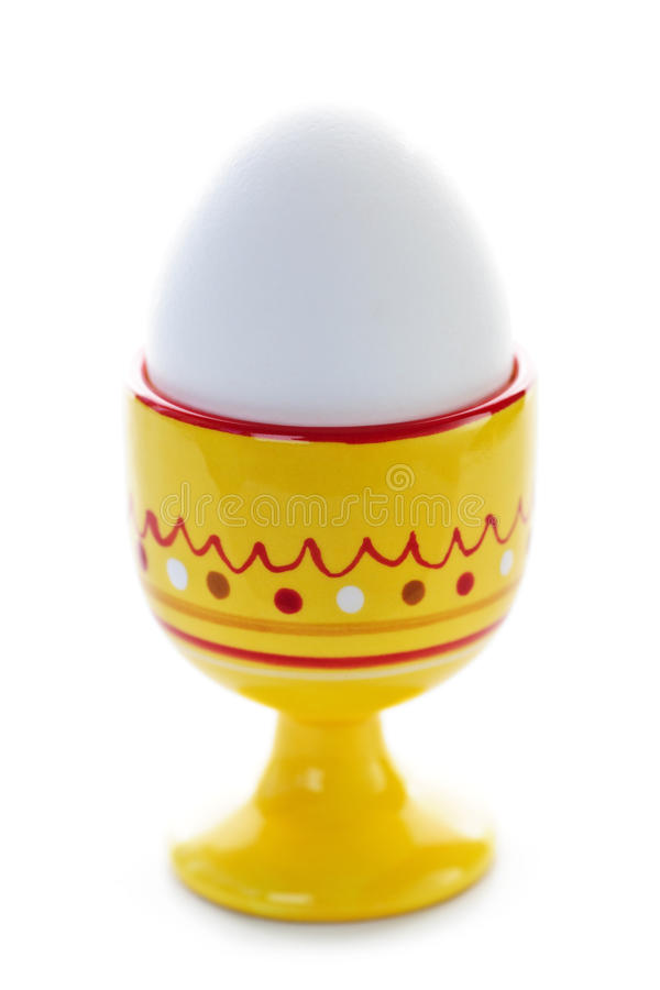 Boiled egg in cup royalty free stock photos