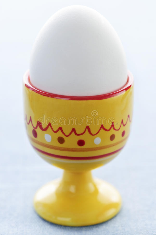 Boiled egg in cup stock image